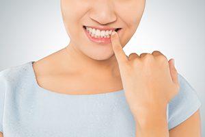 Woman Checking Teeth